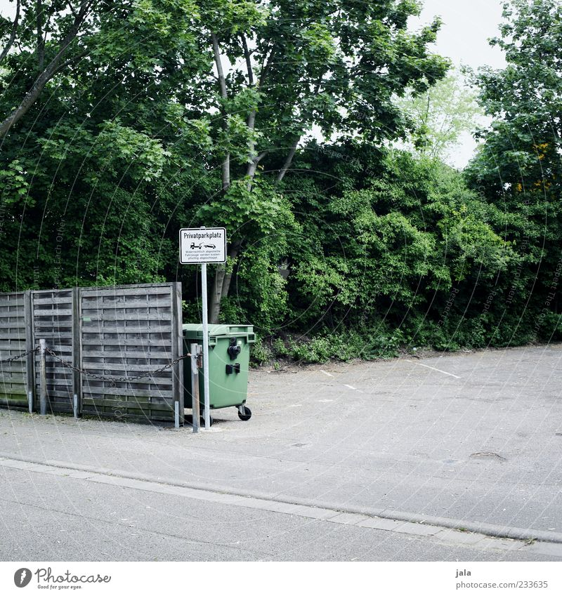 private parking Nature Plant Tree Bushes Places Parking lot Wooden fence Trash container Signs and labeling Signage Warning sign Gloomy Colour photo