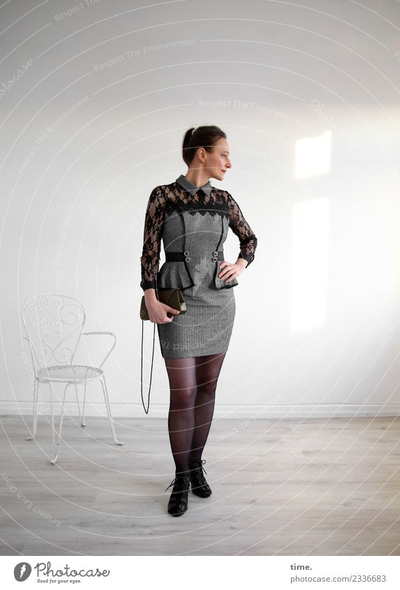 bia Chair Room Feminine Woman Adults 1 Human being Dress Handbag Brunette Long-haired Braids Observe To hold on Looking Stand Esthetic Elegant Beautiful