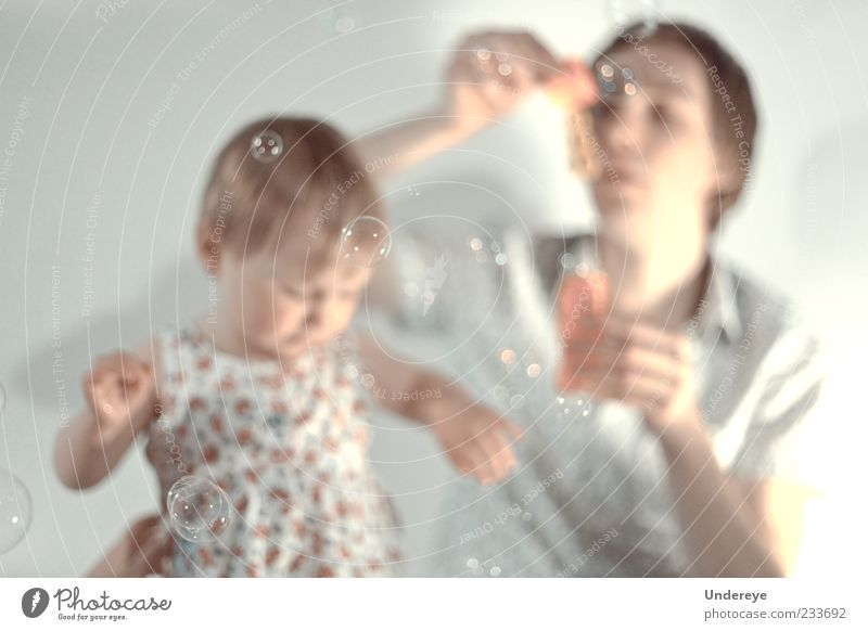 Bubbles Human being Child Man Youth (Young adults) Girl White Life Gray Bright Adults Soft Warm-heartedness Father Bubble To enjoy Toddler
