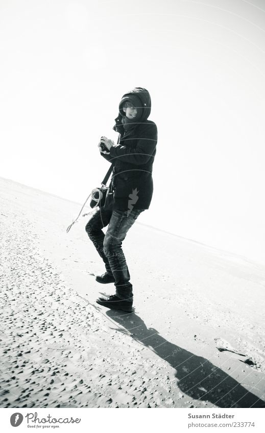 Spiekeroog good times Walking Cold Beach Hooded (clothing) Running Black & white photo Exterior shot Shadow Contrast Sunlight Central perspective Full-length