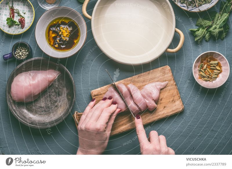 Hands cut chicken breast on the kitchen table Food Meat Nutrition Organic produce Diet Crockery Bowl Knives Style Design Healthy Eating Living or residing Table