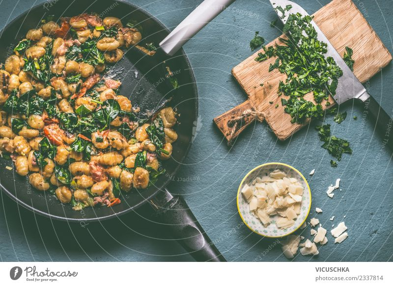 Gnocchi pan with spinach Food Meat Sausage Vegetable Nutrition Lunch Dinner Crockery Pan Knives Style Design Living or residing Table Kitchen Sauce Cooking