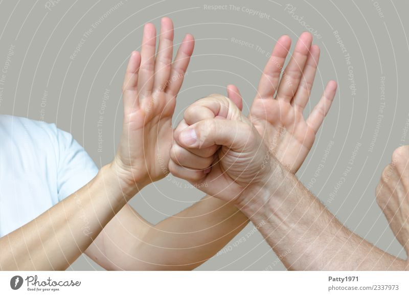 Woman has raised both hands defensively against a man who threatens her with clenched fists. Detail of the hands. Human being Masculine Feminine Adults Man Arm