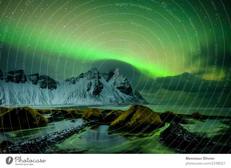 Northern lights over Vestrahorn, Iceland Vacation & Travel Adventure Mountain Environment Nature Landscape Clouds Aurora Borealis Peak Snowcapped peak Coast