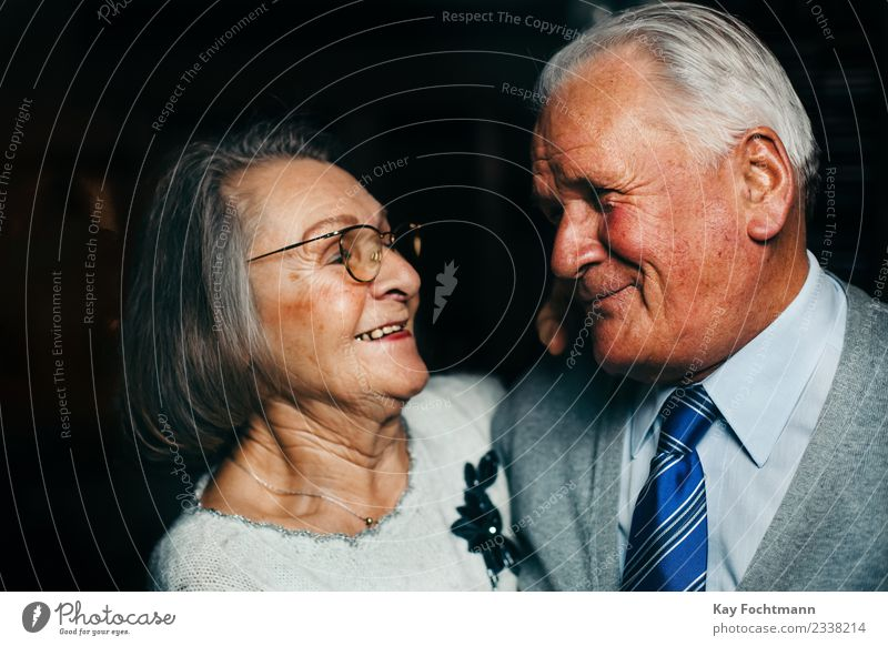 Smiling senior couple looks lovingly into each other's eyes Healthy Care of the elderly Harmonious Well-being Contentment Female senior Woman Male senior Man