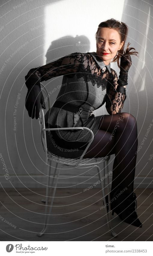 Woman Human being Beautiful Dark Adults Feminine Fashion Think Moody Room Sit Wait Observe Cool (slang) Curiosity Chair