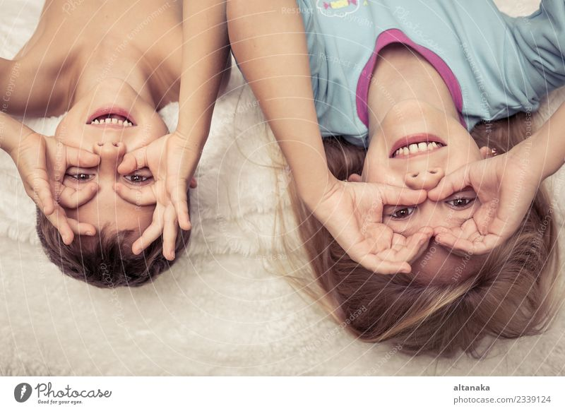 Lovely brother and sister lying in bed at home. Concept of Brother And Sister Together Forever Lifestyle Joy Happy Beautiful Face Relaxation Playing Bedroom