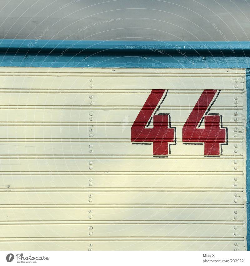 45 Sign Blue Red White Digits and numbers House number 44 Midlife Crisis Colour photo Multicoloured Exterior shot Pattern Structures and shapes Deserted