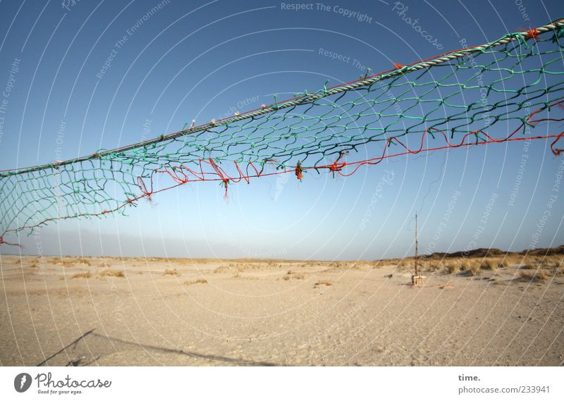 Spiekeroog, play with the wind. Beach Sand Sky Volleyball net Net Broken Torn Defective Shadow Multicoloured String Diagonal Tall Signs and labeling
