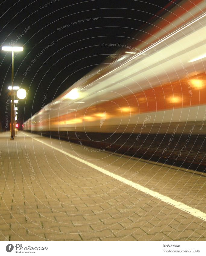Arriving train Railroad Platform Night Movement Driving Long exposure Motion blur Transport Train station