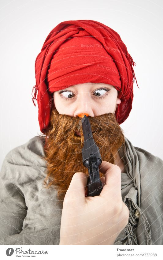 Human being Woman Man Adults Funny Feasts & Celebrations Fear Masculine Threat Carnival Facial hair Carnival costume Weapon Squint Handgun Shot