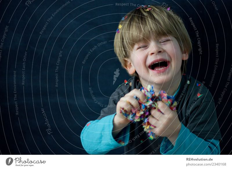 Boy has fun with confetti Lifestyle Style Joy Happy Feasts & Celebrations Human being Masculine Child Boy (child) Infancy Face 1 3 - 8 years Laughter Authentic