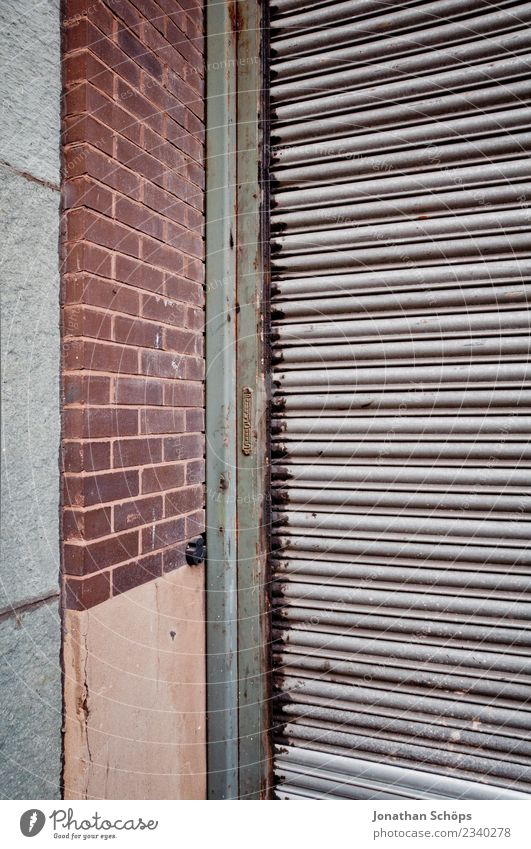 garage door Town Outskirts Manmade structures Building Wall (barrier) Wall (building) Facade Old Poverty Hideous Gate Garage door Structures and shapes Corner