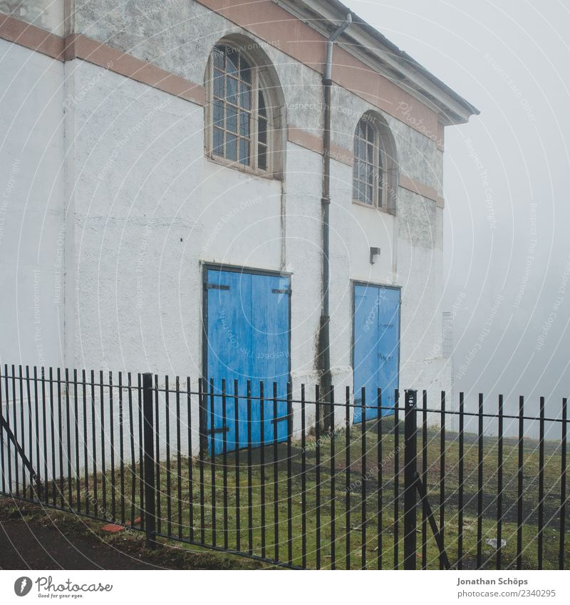 House in the fog in Glasgow Town House (Residential Structure) Esthetic Fog Shroud of fog Haze Scotland Fence Door Blue Facade Creepy Misty atmosphere