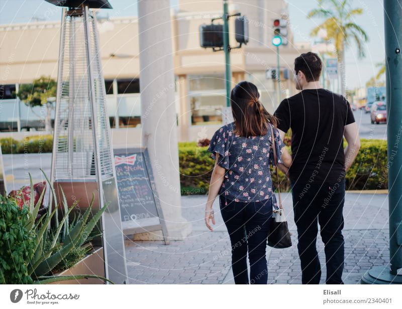 Young couple walking through the city Lifestyle Joy Leisure and hobbies Human being Young woman Youth (Young adults) Young man Woman Adults Man