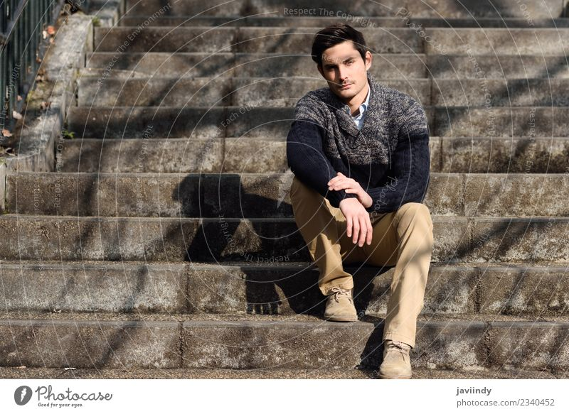 Atractive young man sitting on urban steps Human being Youth (Young adults) Man Young man White 18 - 30 years Face Adults Lifestyle Autumn Style