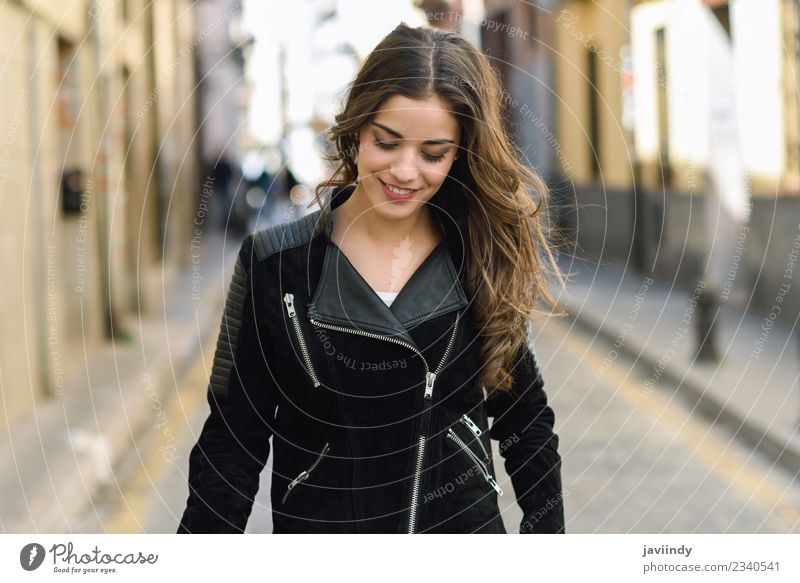 Portrait of young woman smiling in urban background Woman Human being Youth (Young adults) Young woman Beautiful White 18 - 30 years Face Street Adults