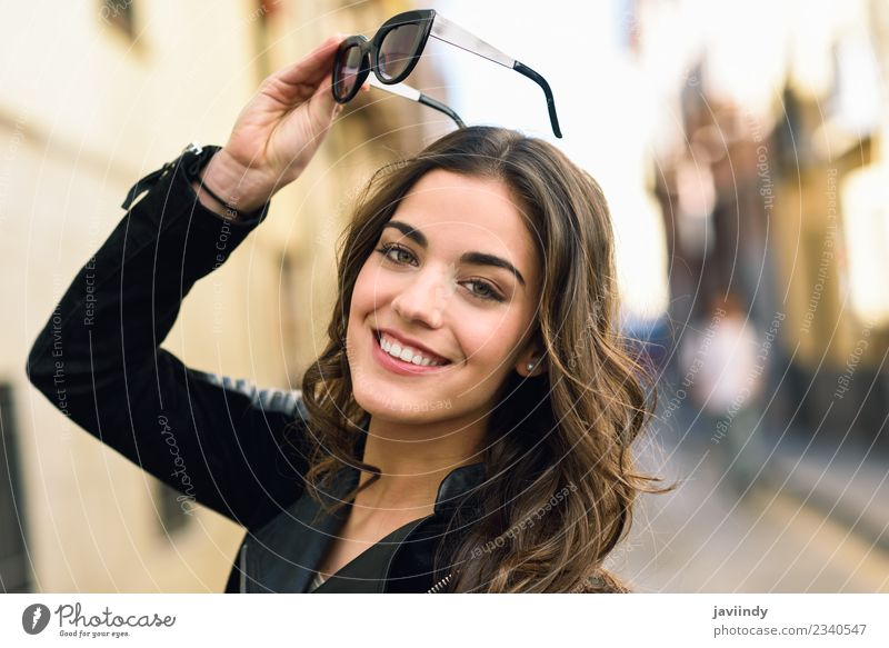 Portrait of young woman smiling with sunglasses Woman Human being Youth (Young adults) Young woman Beautiful White Joy 18 - 30 years Face Street Adults