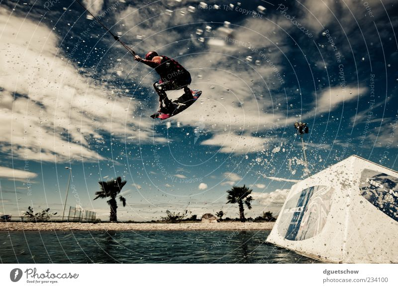 Human being Summer Joy Jump Leisure and hobbies Flying Masculine Lifestyle Athletic Aquatics Worm's-eye view Action Perspective Splash of water