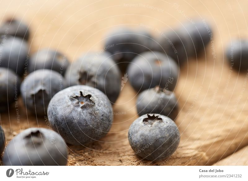 close up of blueberry on vintage, wooden table Fruit Dessert Nutrition Eating Breakfast Vegetarian diet Diet Juice Summer Table Group Nature Wood Fitness