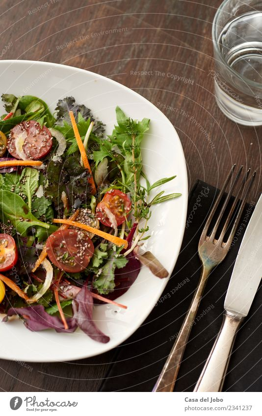 fresh salad on dark wooden table Vegetable Nutrition Eating Lunch Dinner Vegetarian diet Diet Plate Glass Knives Fork Lifestyle Overweight Relaxation Table