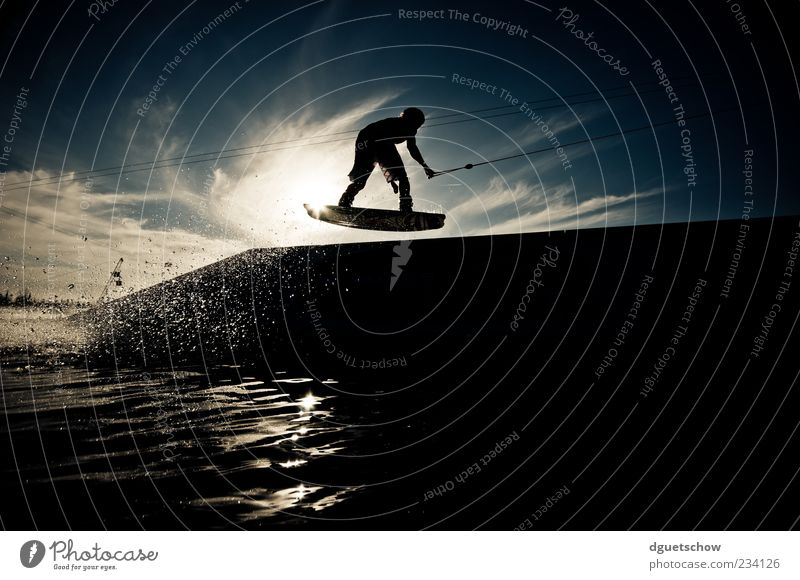 table Style Leisure and hobbies Sports Aquatics wakeboarding water ski facility Masculine Jump Colour photo Exterior shot Day Light Shadow Contrast Silhouette