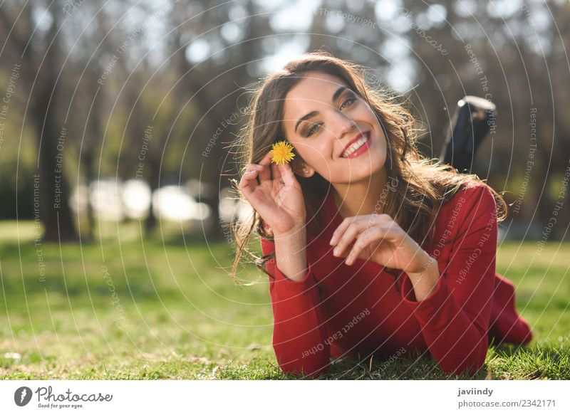 Smiling woman lying on grass in urban park. Woman Human being Nature Youth (Young adults) Young woman Summer Beautiful Flower Red Relaxation Joy 18 - 30 years