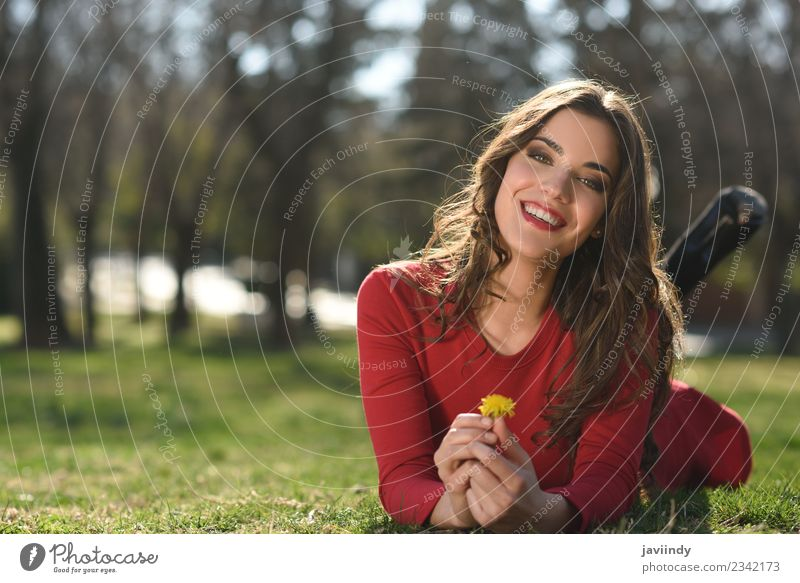 young woman rest in the park smiling with a dandelion Woman Human being Nature Youth (Young adults) Young woman Beautiful Flower Red Joy 18 - 30 years Adults