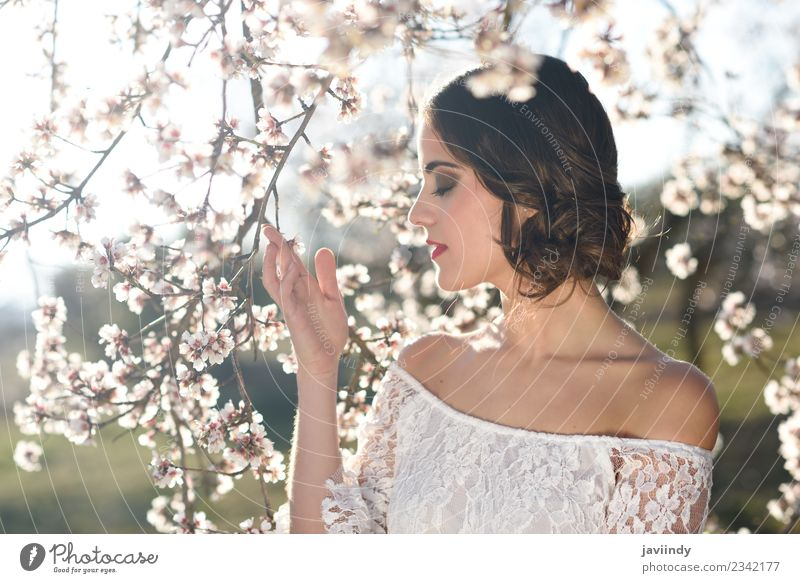 Young woman between almonds flowers in spring time Style Beautiful Face Human being Feminine Youth (Young adults) Woman Adults 1 18 - 30 years Nature Tree