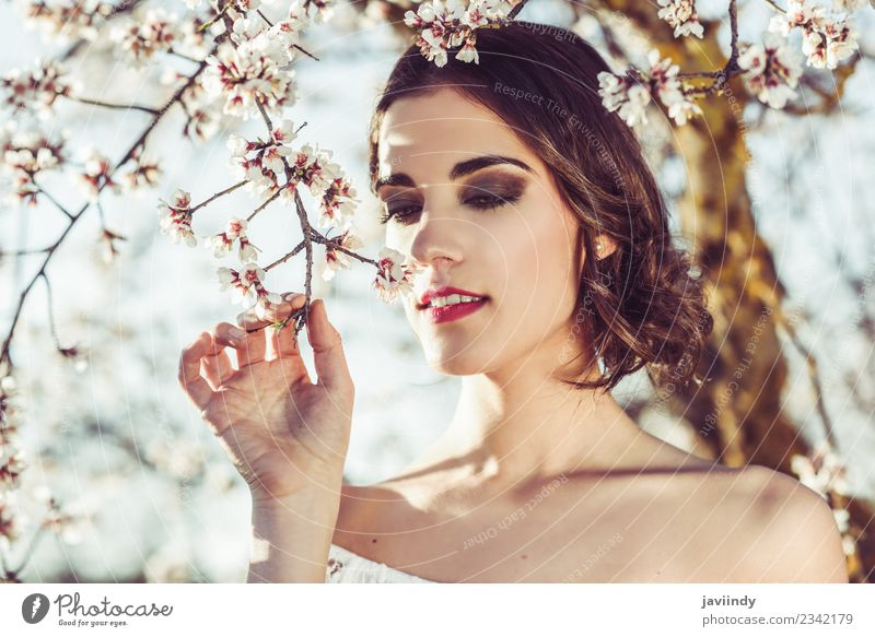 Young woman smelling almond flowers in springtime Style Happy Beautiful Hair and hairstyles Face Wedding Human being Feminine Youth (Young adults) Woman Adults