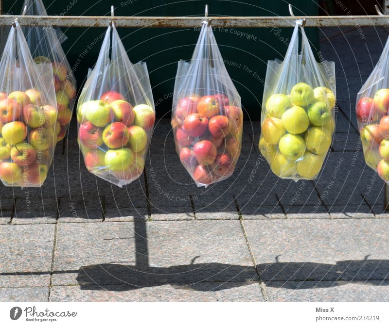 Nutrition Food Fruit Fresh Multiple Round Apple Markets Row Delicious Hang Organic produce Sell Paper bag Store premises Pouch