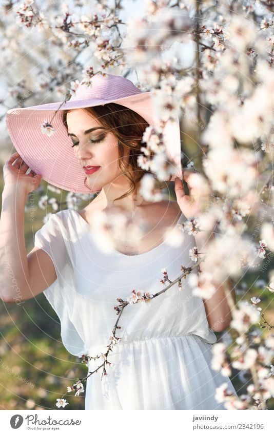 Young woman between almonds flowers in spring time Style Happy Beautiful Hair and hairstyles Face Human being Feminine Youth (Young adults) Woman Adults 1
