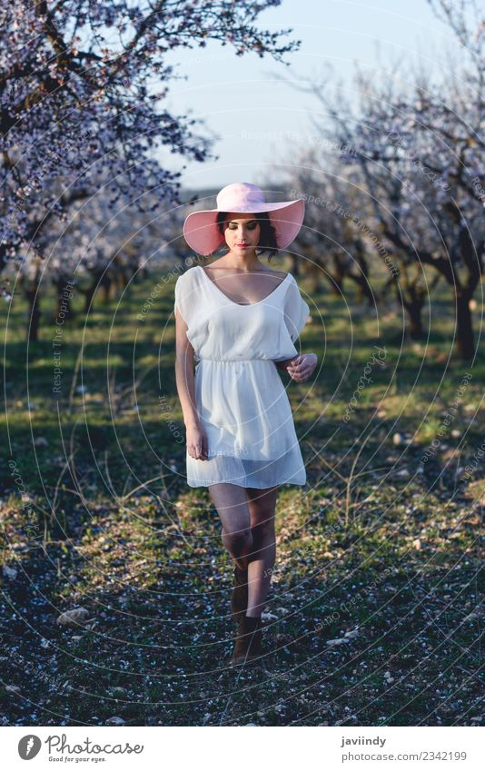 Young woman in almond flowered field in spring time Style Happy Beautiful Hair and hairstyles Face Human being Feminine Youth (Young adults) Woman Adults 1