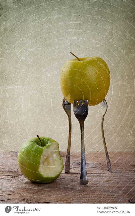 Two apples Food Fruit Apple Nutrition Organic produce Vegetarian diet Diet Fork Wood Metal Esthetic Exceptional Brown Yellow Green Colour photo Interior shot