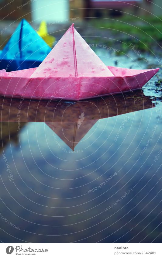 Color paper boats in the water Environment Nature Water Drops of water Autumn Winter Climate Weather Bad weather Rain Toys Paper Paper boat Puddle Authentic
