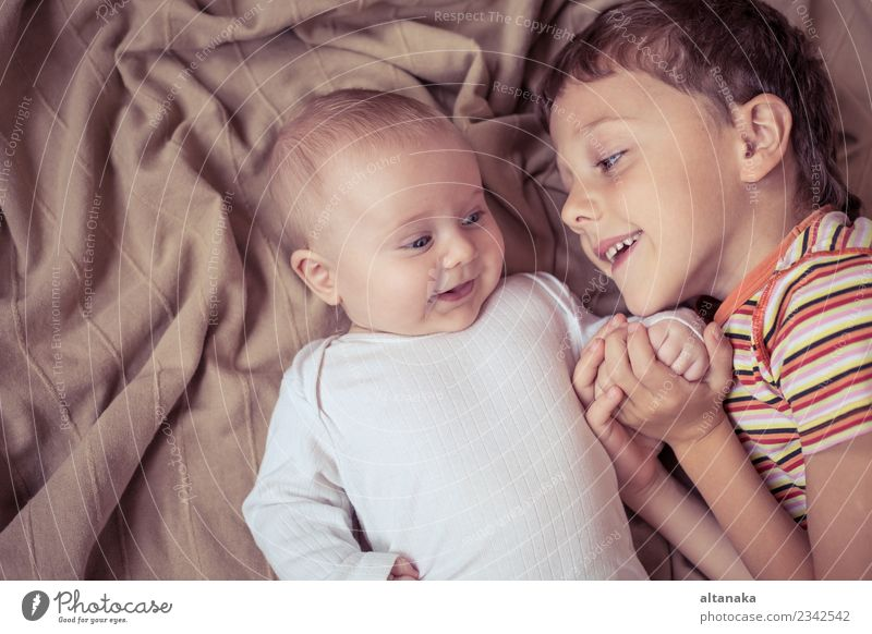 little boy playing with newborn on the bed at the day time Joy Happy Playing Bedroom Child Baby Toddler Boy (child) Family & Relations Friendship Infancy Hand