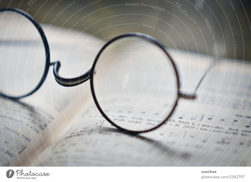 see Eyeglasses sehkrücke Reading Shallow depth of field Blur Book Sing Song book Musical notes Religion and faith Belief Church nickel glasses Glass Vision