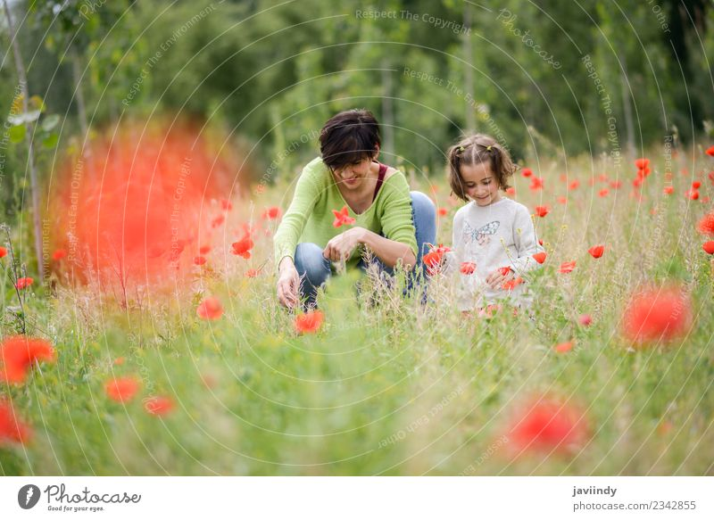 Happy mother with her little daughter in poppy field Woman Child Human being Nature Youth (Young adults) Flower Joy Girl Adults Lifestyle Love Meadow