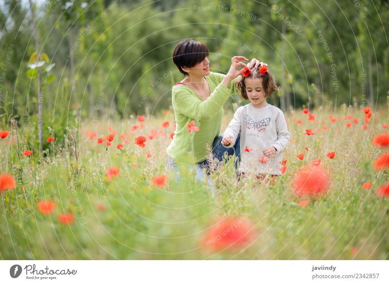 Happy mother with her little daughter in poppy field Woman Child Human being Nature White Flower Joy Girl Adults Lifestyle Love Meadow Family & Relations Grass