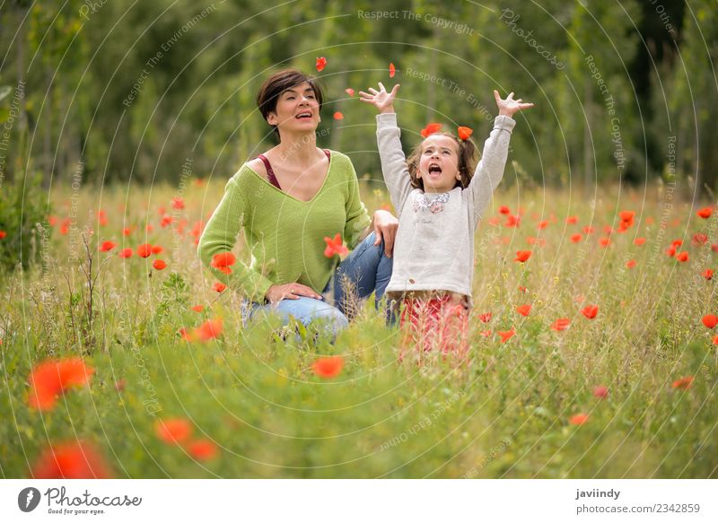 Happy mother with her little daughter in poppy field Woman Child Human being Nature White Flower Joy Girl Adults Lifestyle Love Meadow Emotions Feminine
