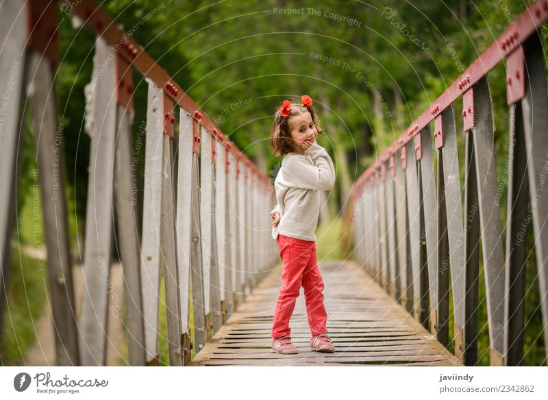 Cute little girl with four years old in a rural bridge Joy Happy Beautiful Life Playing Child Human being Baby Girl Woman Adults Infancy 1 3 - 8 years Nature