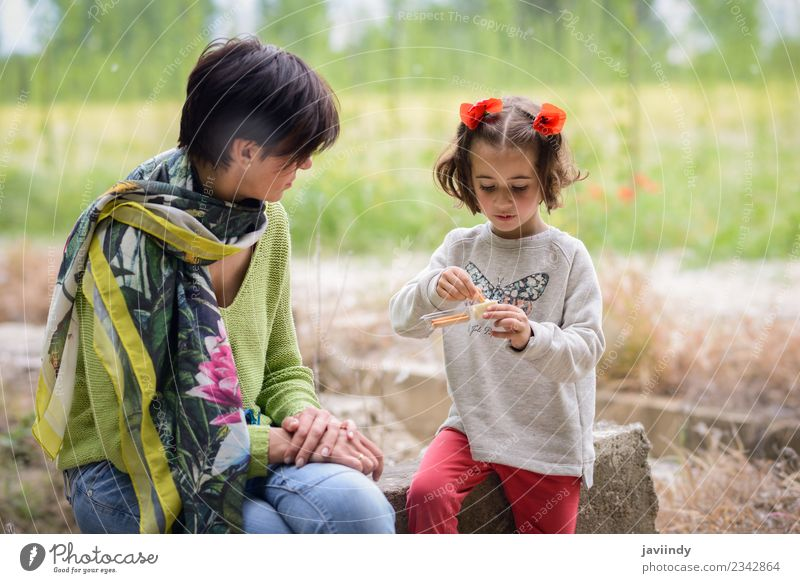Happy mother with her little daughter picnicking Woman Child Human being Nature White Joy Girl Adults Lifestyle Love Meadow Family & Relations Small Playing