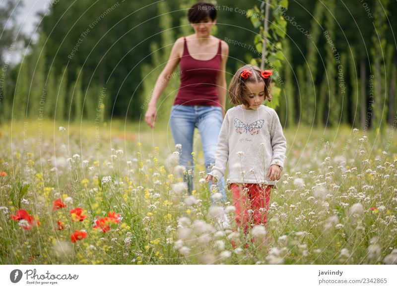Happy mother with her little daughter in poppy field Woman Child Human being Nature Youth (Young adults) White Flower Girl Adults Lifestyle Meadow Feminine