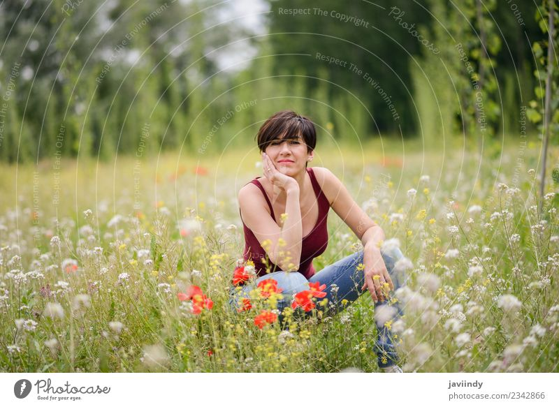 Happy woman with short hair enjoying flowered field. Woman Human being Nature Youth (Young adults) Beautiful Flower Joy 18 - 30 years Adults Lifestyle Love