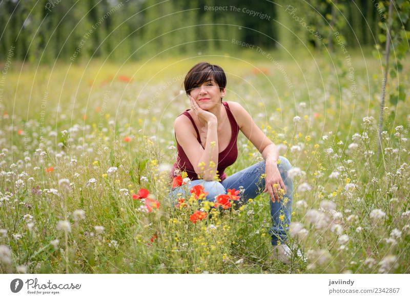 Happy woman with short haircut in poppies field. Woman Child Human being Nature Youth (Young adults) Young woman Beautiful White Flower Joy Adults Lifestyle