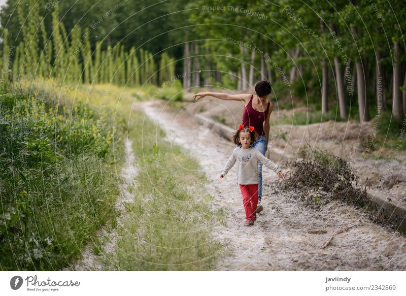 Happy mother with her little daughter in rural road. Woman Child Human being Nature White Flower Girl Adults Lifestyle Love Meadow Family & Relations Grass