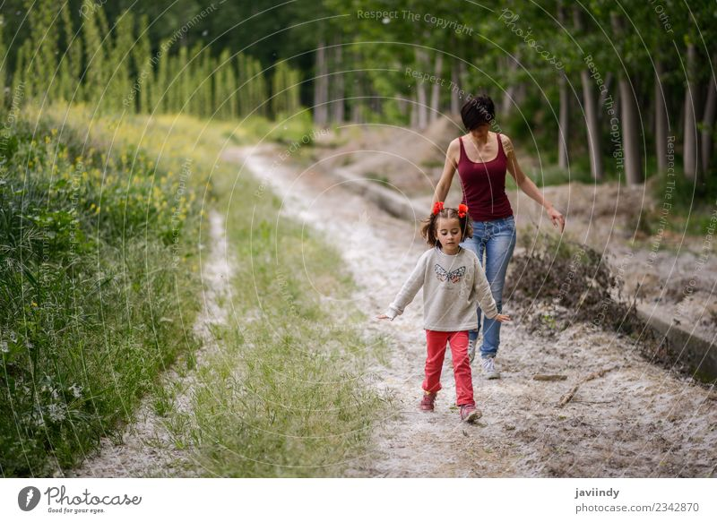 Happy mother with her little daughter in rural road. Lifestyle Playing Child Human being Baby Woman Adults Parents Mother Family & Relations Infancy 2