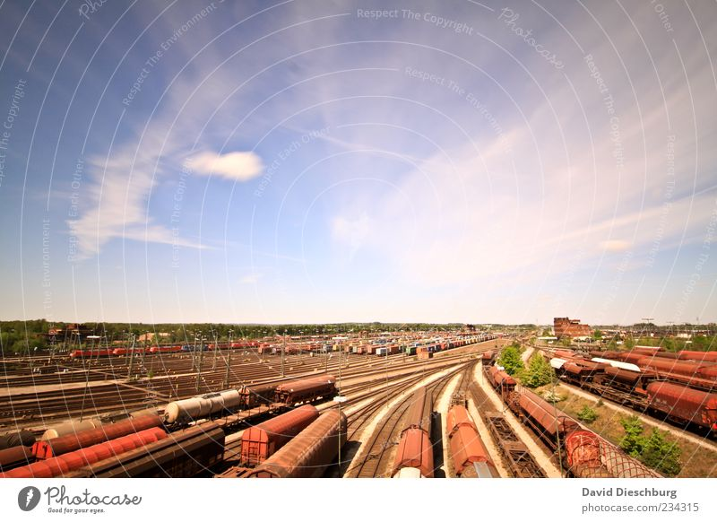 Blue Red Clouds Far-off places Horizon Brown Transport Railroad Beautiful weather Logistics Railroad tracks Traffic infrastructure Train station Blue sky