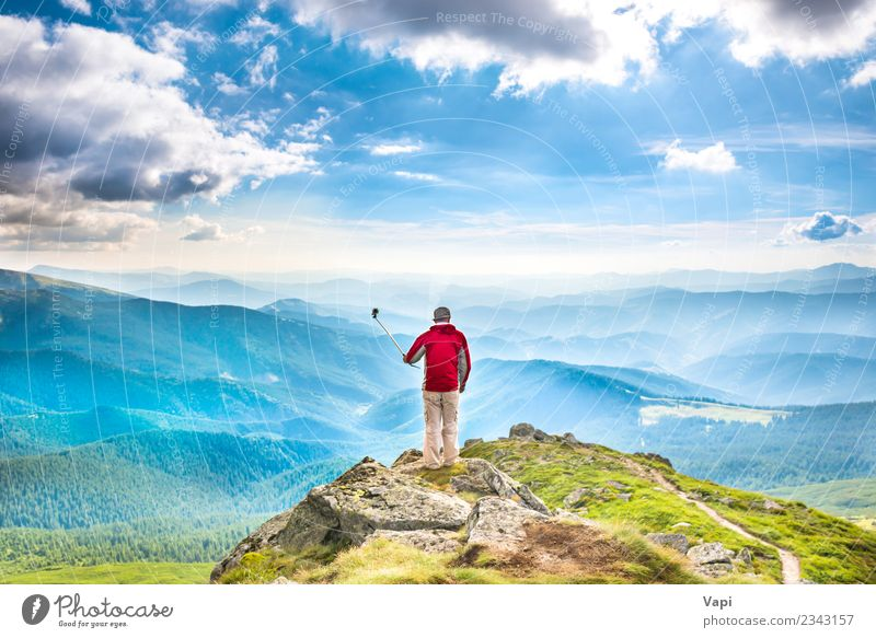 Young man on the top of mountain taking picture with smartphone Lifestyle Joy Beautiful Leisure and hobbies Vacation & Travel Tourism Trip Adventure