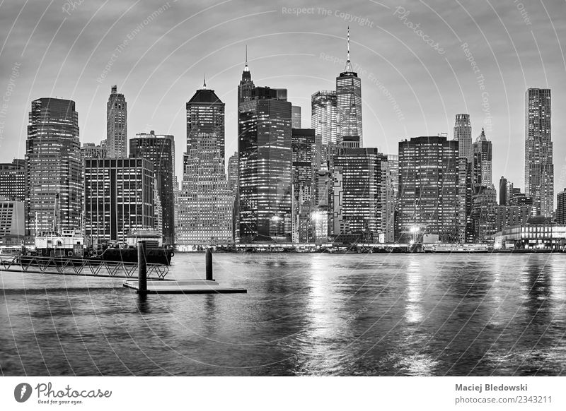 Black and white New York City skyline at night. Sky Architecture Wall (building) Building Business Wall (barrier) Office High-rise Success USA River Skyline